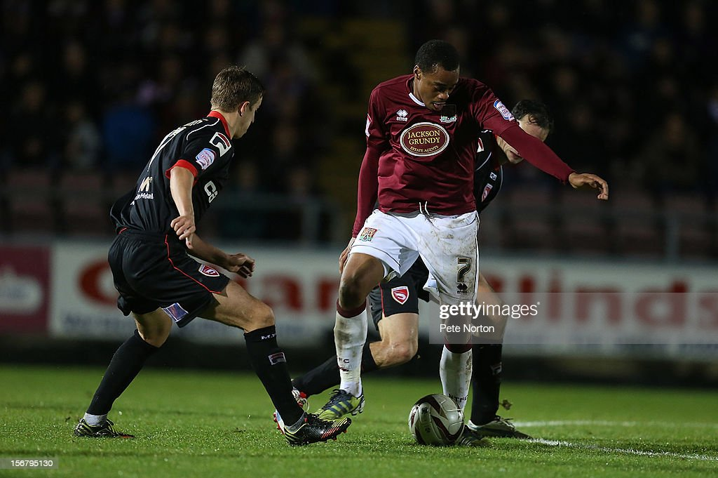 Ishmel Demontagnac of Northampton Town looks to control the ball under pressure from Stewart Drummond and Andy Fleming of Morecambe during the npower League Two match between Northampton Town and Morecambe at Sixfields Stadium on November 20, 2012 in Northampton, England.