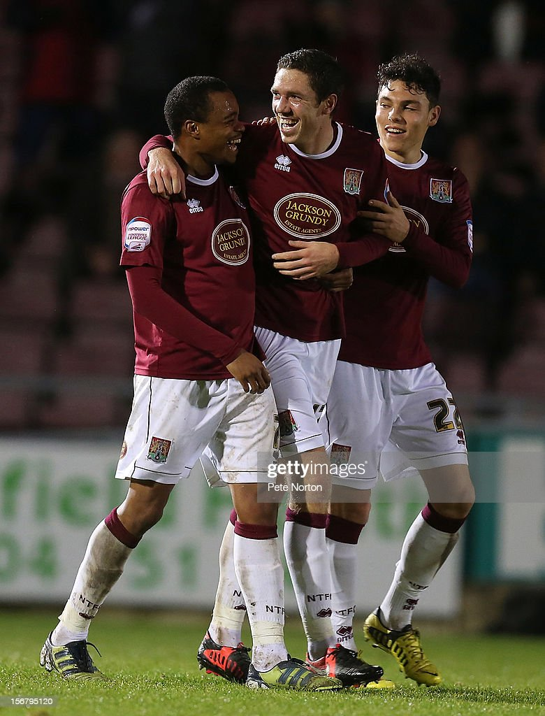Ishmel Demontagnac,Ben Tozer and Lewis Hornby of Northampton Town celebrate after Kevin Ellison of Morecambe had scored an own goal for Northampton's 2nd goal during the npower League Two match between Northampton Town and Morecambe at Sixfields Stadium on November 20, 2012 in Northampton, England.
