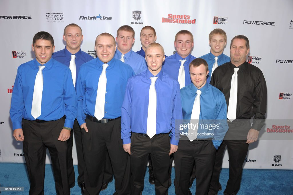 Ishpeming Football Coach Jeff Olson (R), kicker Eric Dompierre (2nd R), and the Ishpeming High School football team at the 2012 Sports Illustrated Sportsman of the Year award presentation at Espace on December 5, 2012 in New York City.