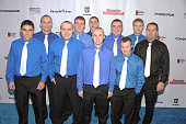 Ishpeming Football Coach Jeff Olson kicker Eric Dompierre and the Ishpeming High School football team at the 2012 Sports Illustrated Sportsman of the...