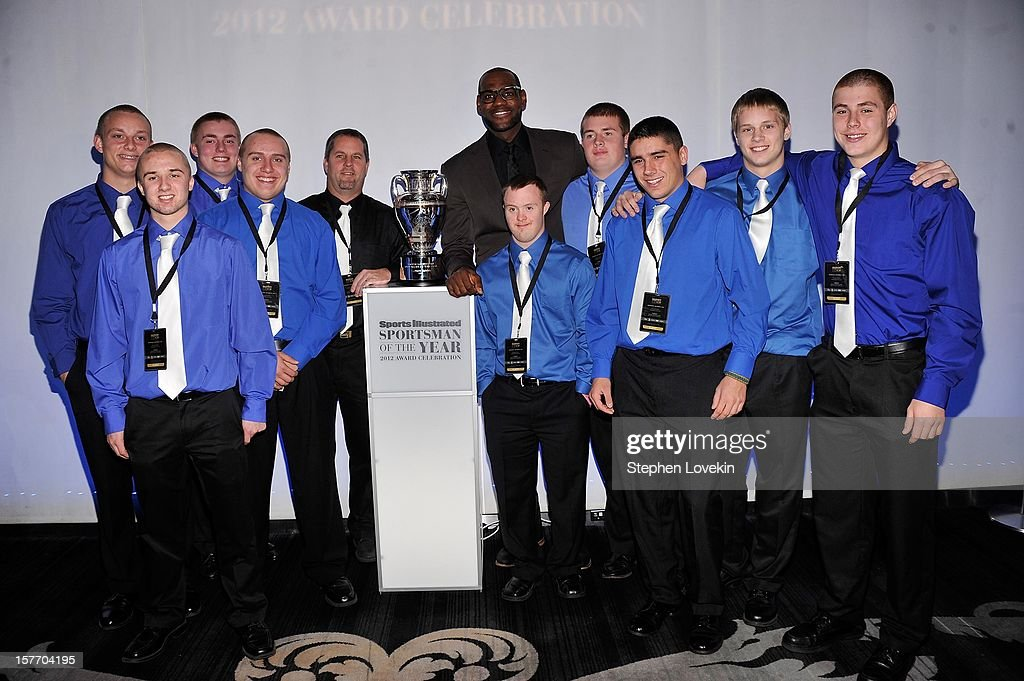 Ishpeming Football Coach Jeff Olson, kicker Eric Dompierre, and the Ishpeming High School football team pose with 2012 Sportsman of the year LeBron James (C) at the 2012 Sports Illustrated Sportsman of the Year award presentation at Espace on December 5, 2012 in New York City.