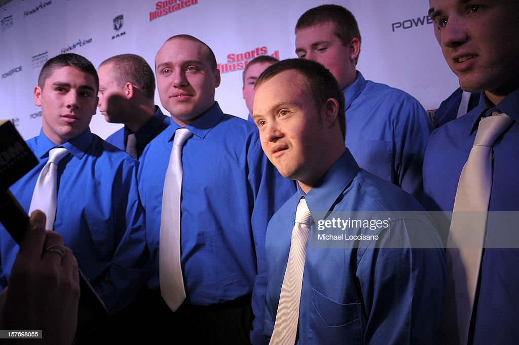 Ishpeming Higih School kicker Eric Dompierre (2nd R) and the Ishpeming High School football team pose at the 2012 Sports Illustrated Sportsman of the Year award presentation at Espace on December 5, 2012 in New York City.