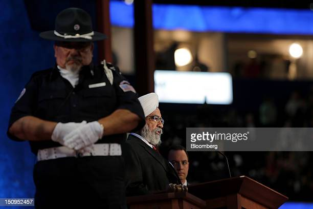 Ishwar Singh head of the Sikh Society of Central Florida center speaks while Reince Priebus chairman of the Republican National Committee right...