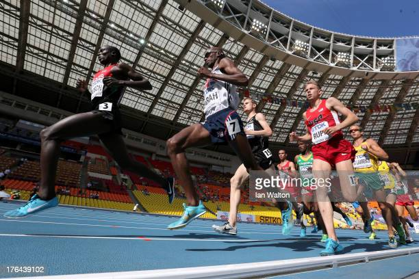 Isiah Kiplangat Koech of Kenya Mo Farah of Great Britain and Galen Rupp of the United States compete during the Men's 5000 metres heats during Day...