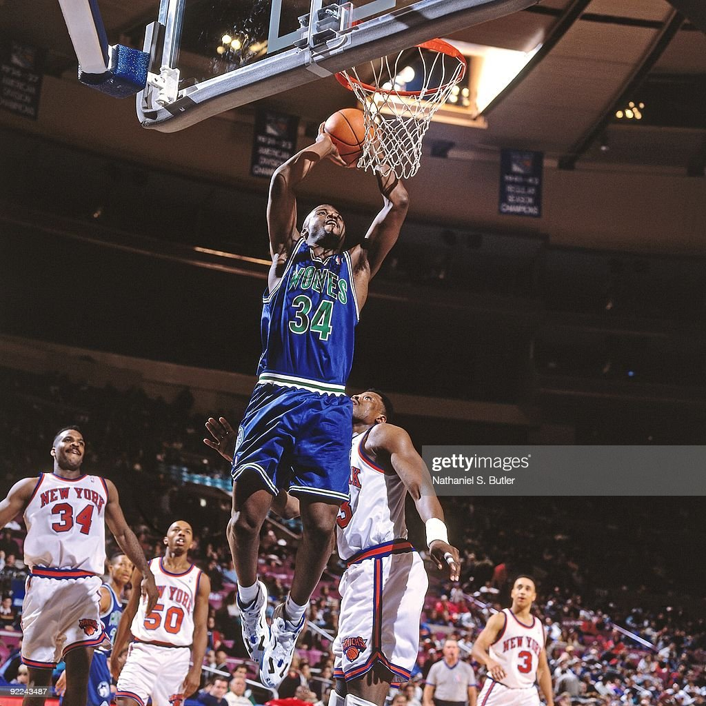 Isiah Rider #34 of the Minnesota Timberwolves dunks against <a gi-track='captionPersonalityLinkClicked' href=/galleries/search?phrase=Patrick+Ewing&family=editorial&specificpeople=202881 ng-click='$event.stopPropagation()'>Patrick Ewing</a> #33 of the New York Knicks during a game played on January 17, 1994 at Madison Square Garden in New York, New York.