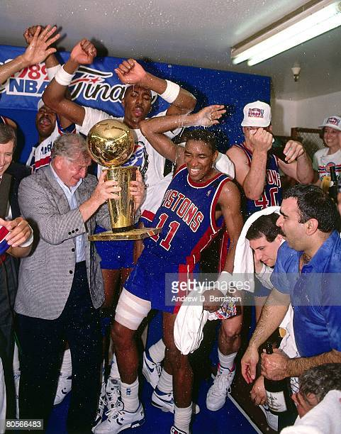 Isiah Thomas and owner William Davidson of the Detroit Pistons celebrate winning Game Four of the 1989 NBA Finals on June 13 1989 at the Great...