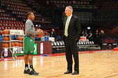 Isiah Thomas and President of Basketball Operations Danny Ainge of the Boston Celtics warm up prior to the start of the game against Emporio Armani...