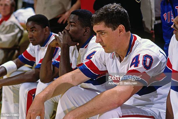 Isiah Thomas Joe Dumars and Bill Laimbeer of the Detroit Pistons sit on the bench during Game Five of the 1988 NBA Finals on June 16 1988 at the...