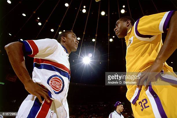 Isiah Thomas of the Detroit Pistons and Magic Johnson of the Los Angeles Lakers meet at center court prior to the NBA game at the Forum in Los...