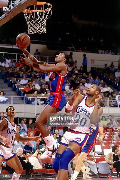 Isiah Thomas of the Detroit Pistons attempts a layup against the Los Angeles Clippers during a 1984 NBA game at the Los Angeles Memorial Sports Arena...