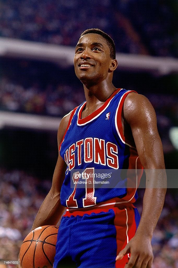 Isiah Thomas #11 of the Detroit Pistons catches his breath during a 1989 NBA game.