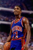 Isiah Thomas of the Detroit Pistons catches his breath during a 1989 NBA game NOTE TO USER User expressly acknowledges that by downloading and or...