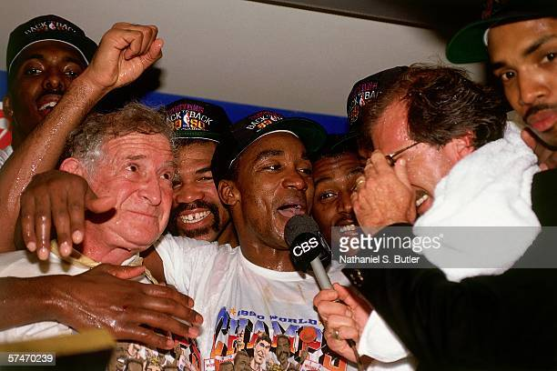 Isiah Thomas of the Detroit Pistons celebrates with teammates following their victory over the Portland Trailblazers in Game five of the NBA Finals...