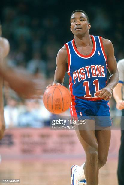 Isiah Thomas of the Detroit Pistons dribbles the ball against the Washington Bullets during an NBA basketball game circa 1990 at The Capital Centre...