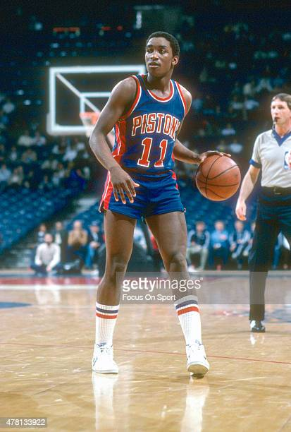 Isiah Thomas of the Detroit Pistons dribbles the ball against the Washington Bullets during an NBA basketball game circa 1983 at The Capital Centre...