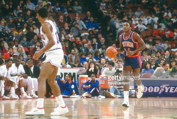 Isiah Thomas of the Detroit Pistons dribbles the ball up court against the Philadelphia 76ers during an NBA basketball game circa 1984 at The...