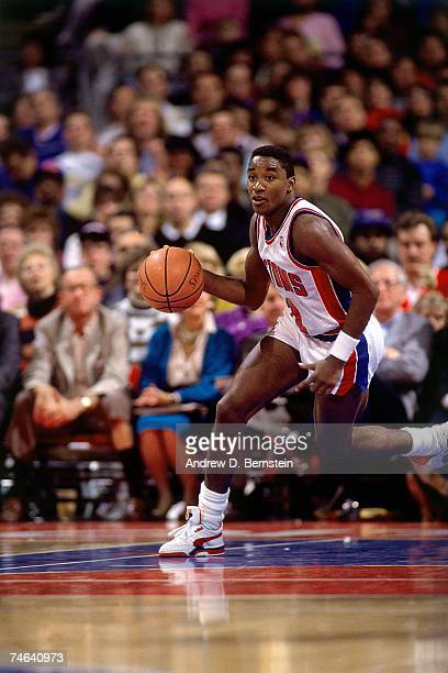 Isiah Thomas of the Detroit Pistons dribbles upcourt during a 1989 NBA game at the Palace of Auburn Hills in Detroit Michigan NOTE TO USER User...