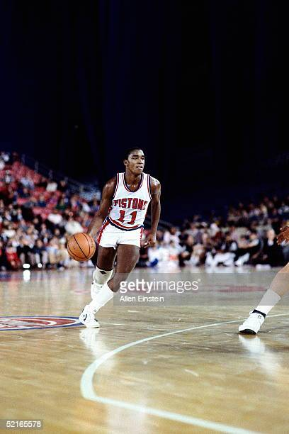 Isiah Thomas of the Detroit Pistons drives around the three point circle during an NBA game at The Pontiac Silverdome circa 1984 in Pontiac Michigan...