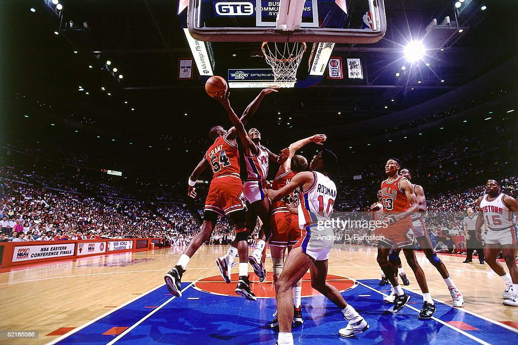 Isiah Thomas of the Detroit Pistons drives to the basket against the Chicago Bulls during an NBA Eastern Conference Finals at The Palace circa 1989...