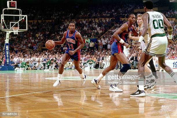 Isiah Thomas of the Detroit Pistons drives to the basket against the Boston Celtics during an NBA game in 1986 at the Boston Garden in Boston...