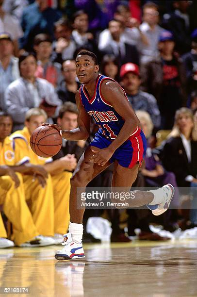 Isiah Thomas of the Detroit Pistons drives to the basket against the Los Angeles Lakers during an NBA game in 1990 at the Great Western Forum in...