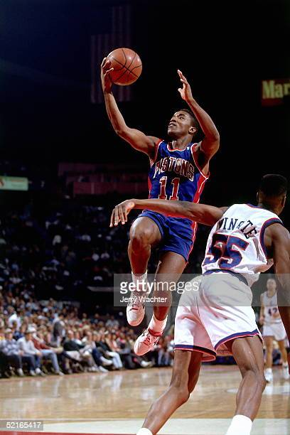 Isiah Thomas of the Detroit Pistons drives to the basket for a layup against the Washington Bullets during an NBA game circa 1991 at the Capital...