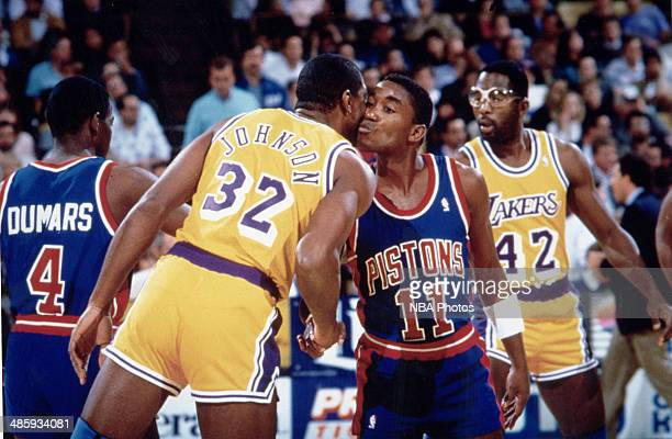 Isiah Thomas of the Detroit Pistons kisses Magic Johnson of the Los Angeles Lakers circa 1990 at the Palace of Auburn Hills in Auburn Hills Michigan...