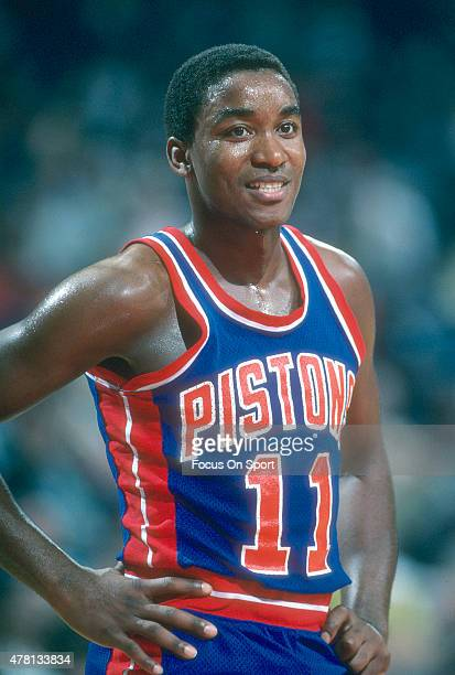 Isiah Thomas of the Detroit Pistons looks on while there's a break in the action against the Washington Bullets during an NBA basketball game circa...
