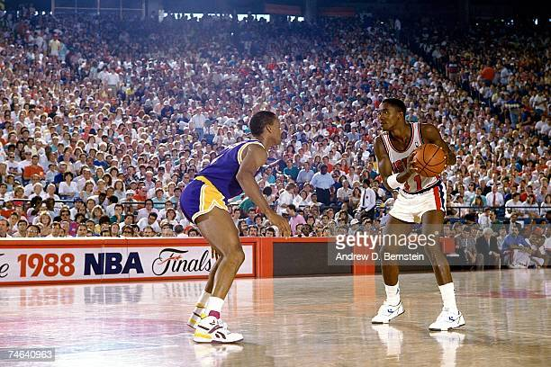 Isiah Thomas of the Detroit Pistons looks to make a move to the basket against the Los Angeles Lakers during the 1988 NBA Finals at the Palace of...