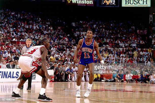 Isiah Thomas of the Detroit Pistons looks to pass against Michael Jordan of the Chicago Bulls during an NBA game in 1989 at the Chicago Stadium in...