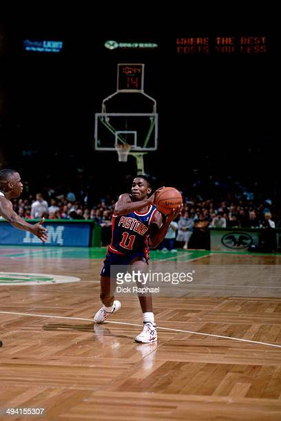 Isiah Thomas of the Detroit Pistons looks to pass the ball against the Boston Celtics during a game played at the Boston Garden in Boston...