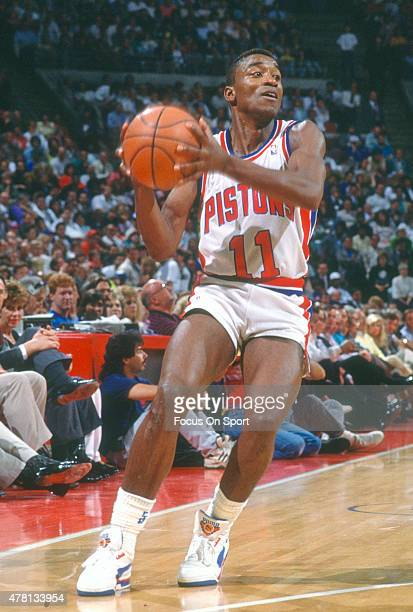 Isiah Thomas of the Detroit Pistons looks to pass the ball during an NBA basketball game circa 1989 at The Palace of Auburn Hills in Auburn Hills...