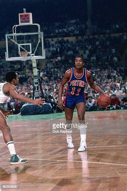 Isiah Thomas of the Detroit Pistons moves the ball up court against the Boston Celtics during a game played in 1984 at the Boston Garden in Boston...