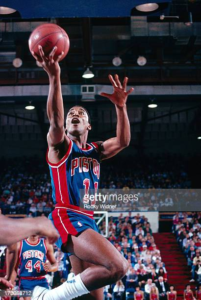 Isiah Thomas of the Detroit Pistons shoots a layup against the Sacramento Kings during a game played on February 23 1988 at Arco Arena in Sacramento...