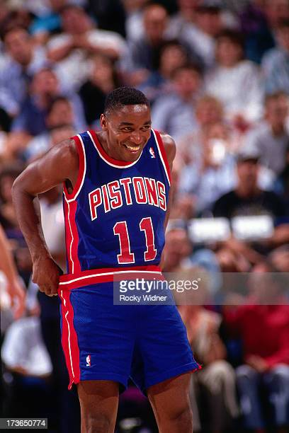 Isiah Thomas of the Detroit Pistons smiles during a game against the Sacramento Kings played on March 14 1994 at Arco Arena in Sacramento California...