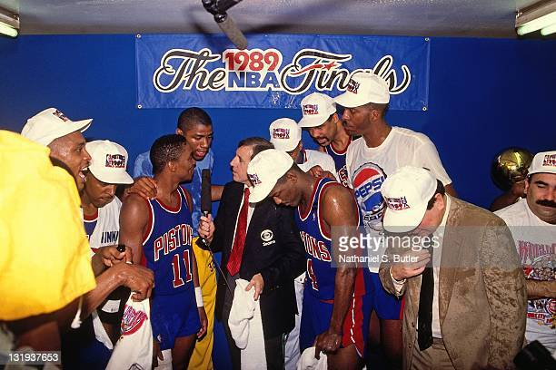 Isiah Thomas of the Detroit Pistons talks with Magic Johnson and Brent Musburger after defeating the Los Angeles Lakers in four games to win the NBA...