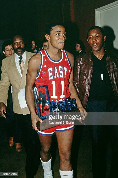 Isiah Thomas of the Eastern Conference AllStars poses with his MVP trophy after the 1984 NBA AllStar game at the McNichols Sports Arena on January 29...