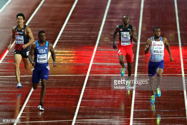Isiah Young of the United States and Nethaneel MitchellBlake of Great Britain compete in the Men's 200 metres semi finals during day six of the 16th...
