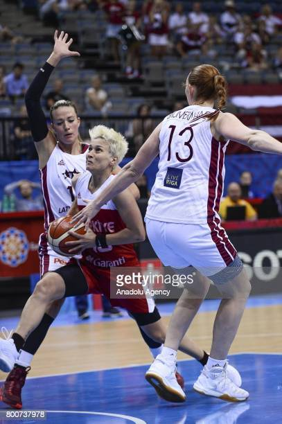 Isil Alben of Turkey in action against Alija Brumermane and Aija Putnina of Latvia during the 2017 FIBA EuroBasket Women qualifications 5 to 6...