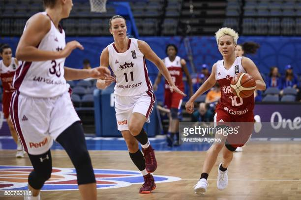 Isil Alben of Turkey in action against Kitija Laksa and Aija Putnina of Latvia during the 2017 FIBA EuroBasket Women qualifications 5 to 6 between...