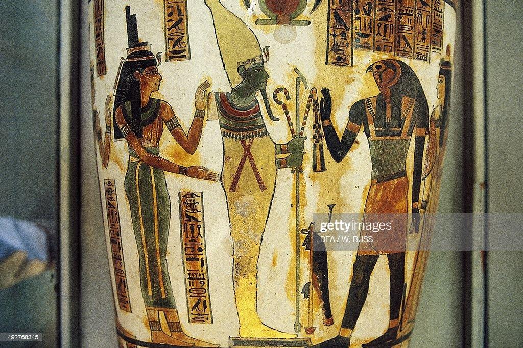 Isis and Horus honouring Osiris shown as mummiform Sarcophagus detail Egyptian civilization Cairo Egyptian Museum