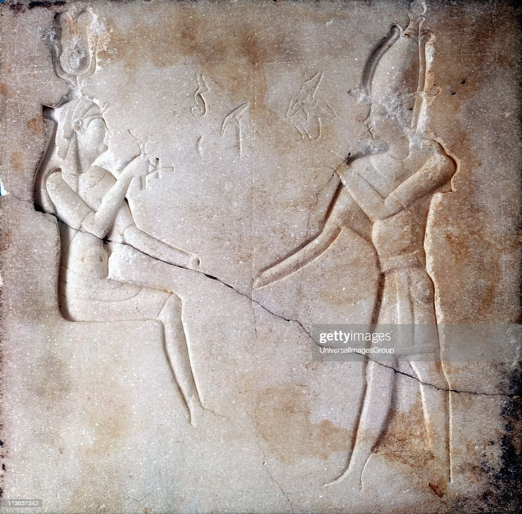 Isis and Osiris Ancient Egyptian gods parents of the falcon god Horus Basrelief Ptoelmaic period