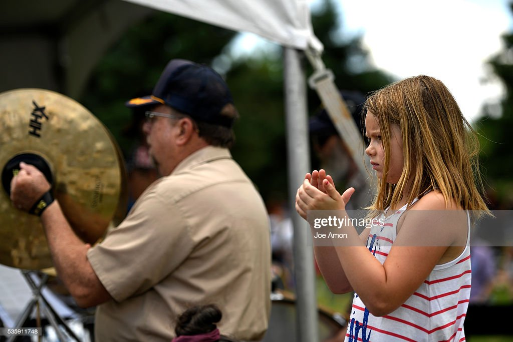 Isis McClure 7 claps with the cymbal's during the Memorial Day ceremony, 84th Anniversary of Remembrance at Fort Logan National Cemetery. May 30, 2016 in Denver, CO.