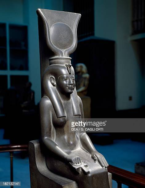 Isis seated wearing a disc set between two cow horns schist statue from Saqqara Detail Egyptian civilisation Late Period Cairo Egyptian Museum