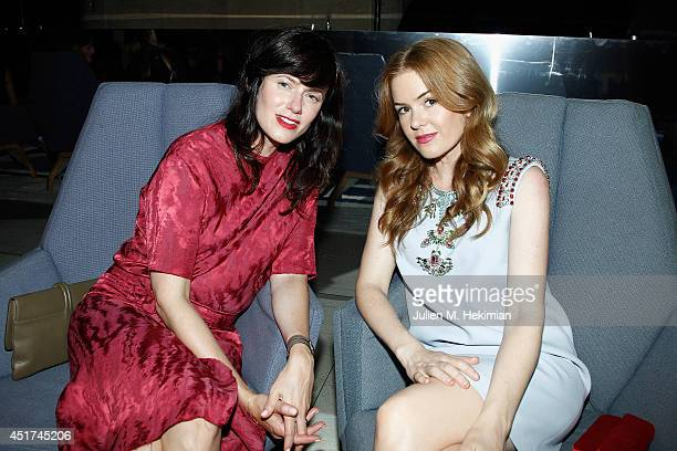 Isla Fisher and guest attend the Miu Miu Resort Collection 2015 at Palais d'Iena on July 5 2014 in Paris France