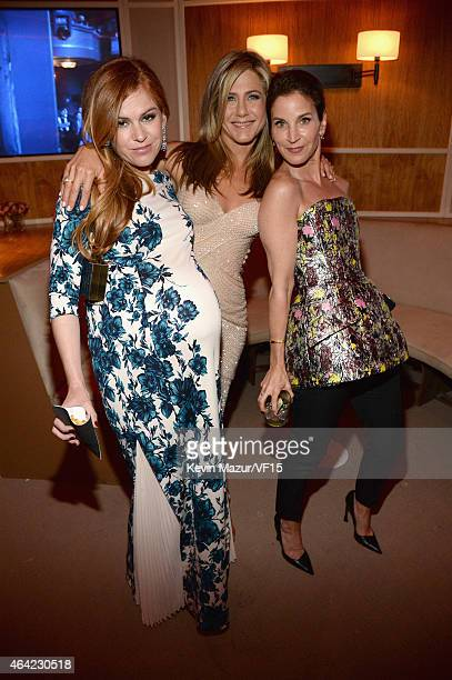 Isla Fisher and Jennifer Aniston attend the 2015 Vanity Fair Oscar Party hosted by Graydon Carter at the Wallis Annenberg Center for the Performing...