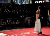 Isla Fisher and Sacha Baron Cohen attend the World Premiere of 'Les Miserables' at Odeon Leicester Square on December 5 2012 in London England