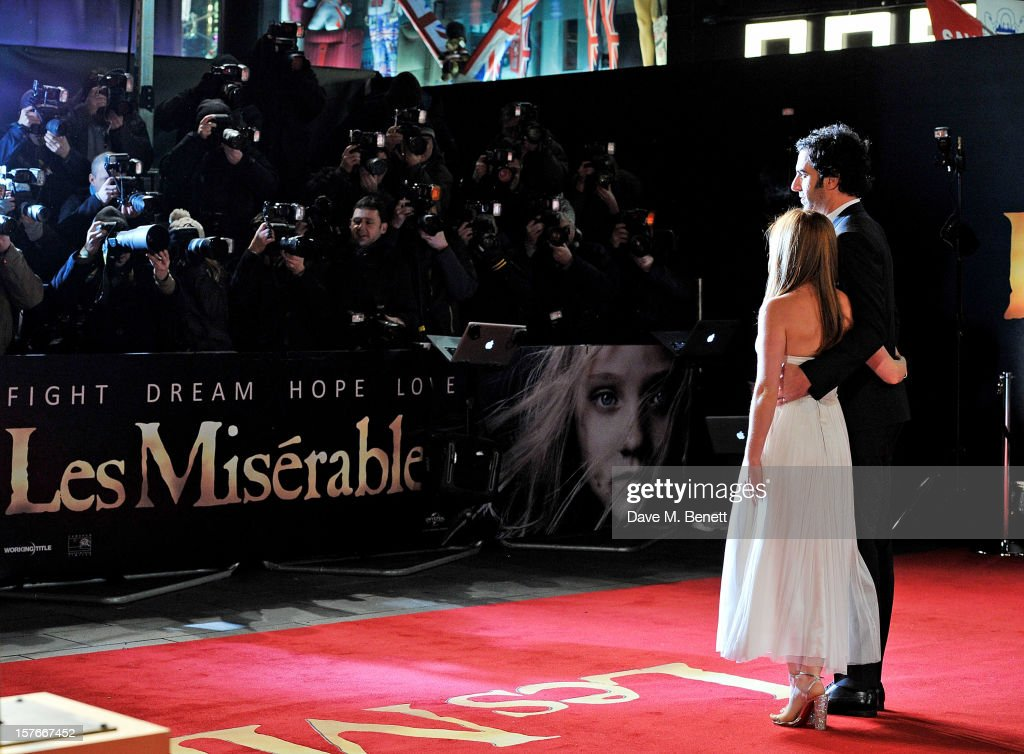 Isla Fisher (L) and Sacha Baron Cohen attend the World Premiere of 'Les Miserables' at Odeon Leicester Square on December 5, 2012 in London, England.
