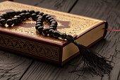 Islamic Book Koran on wooden table