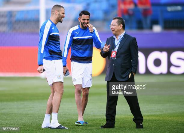 Islam Slimani and Riyad Mahrez of Leicester City laugh with Chairman Vichai Srivaddhanaprabha prior to the UEFA Champions League Quarter Final first...